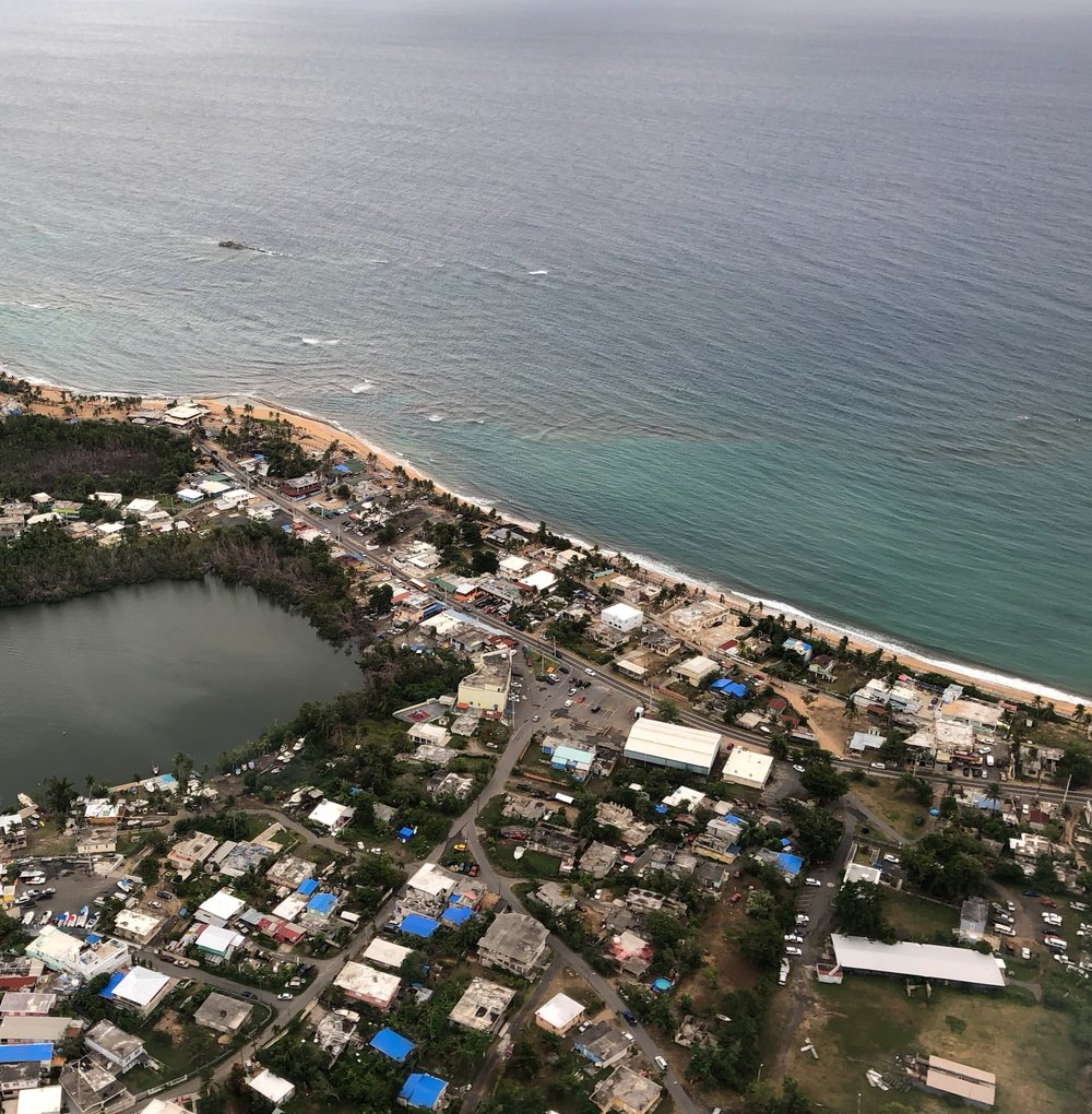 Blue FEMA tarps dotting the Puerto Rican landscape outside of San Juan (Rivera, June 2018)