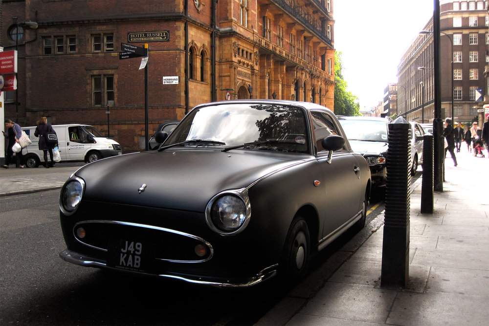 A classic car parked in London