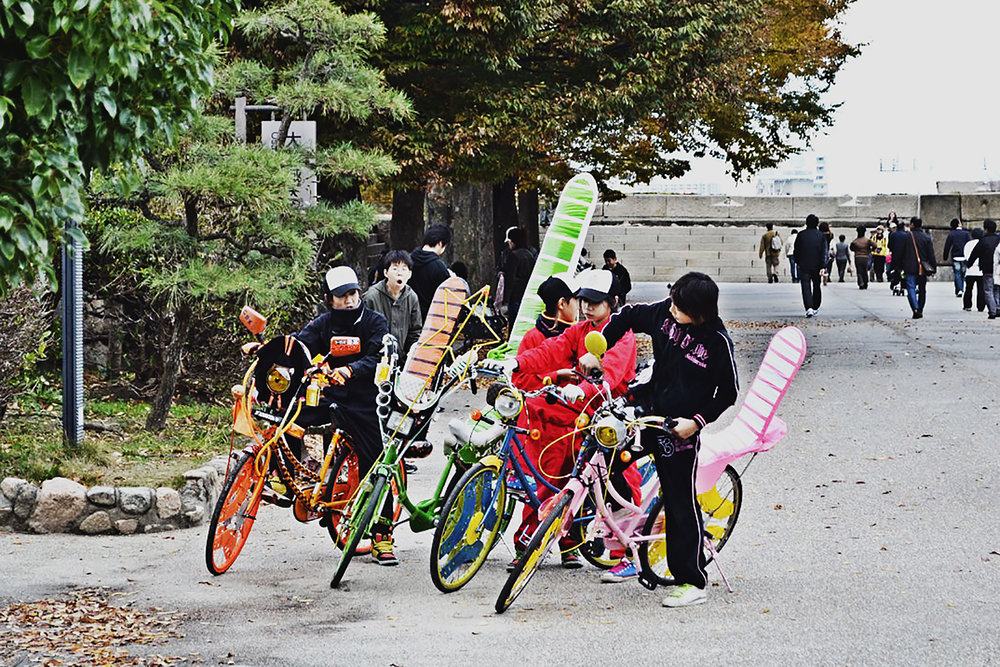 Osaka kids with decked-out bikes.