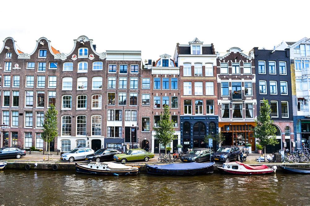 Buildings in Amsterdam - [ BUY GLASS PRINT ]