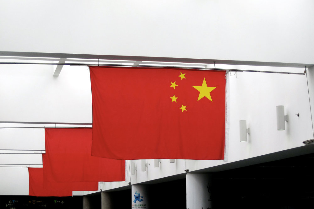 Chinese flags in a subway station