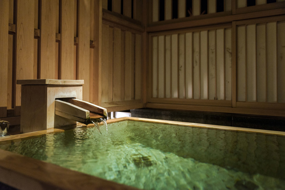 The room's private onsen has constantly running hot spring water