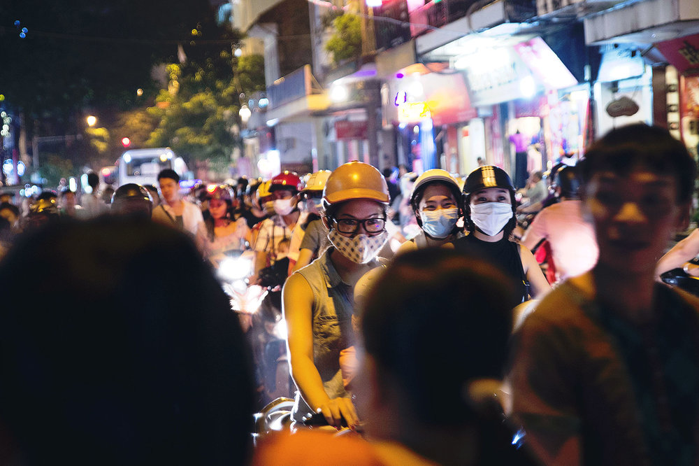 People are stuck in traffic on their mopeds in Hanoi
