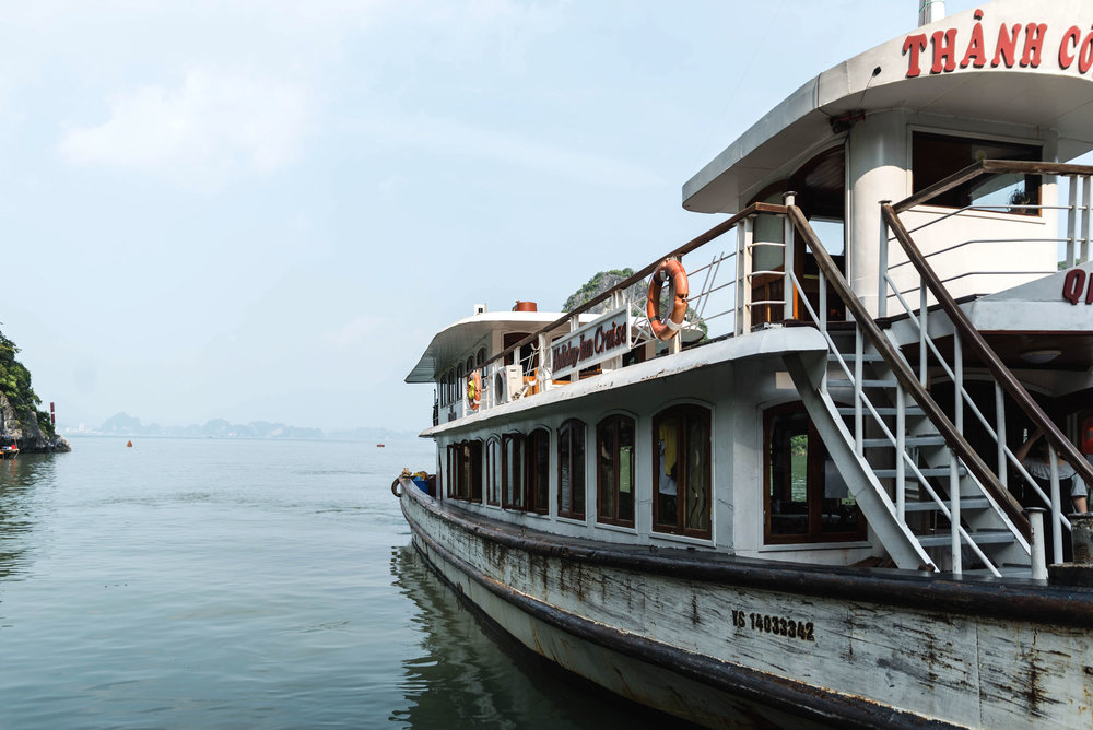 Cruise boat to take the tour group around Ha Long Bay