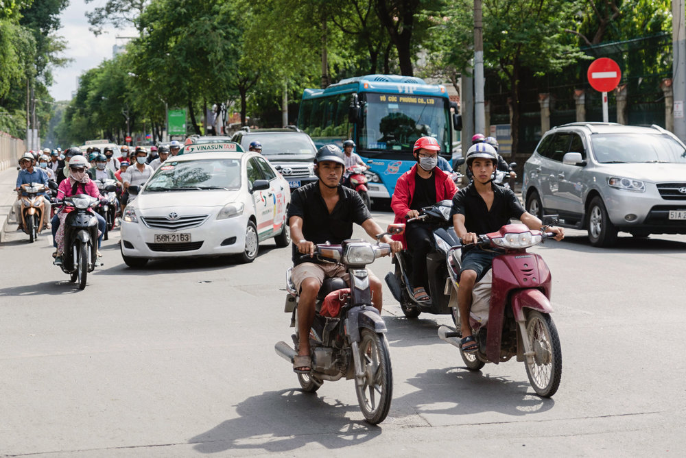 Moped and car traffic in Ho Chi Minh, Vietnam