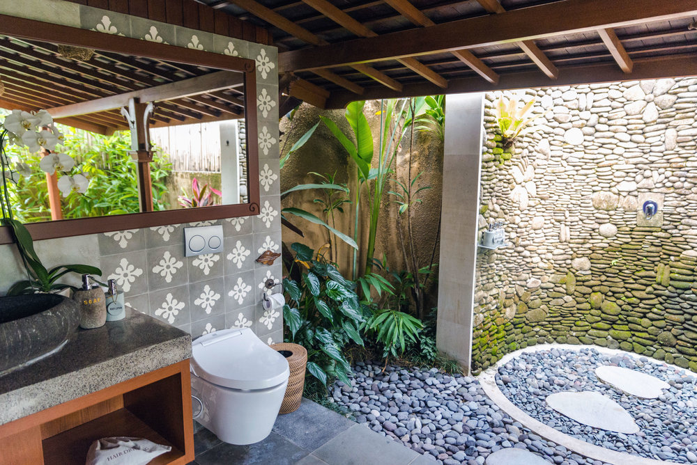 Outdoor bathroom with shower and tub at Nau Villas Ubud, Bali