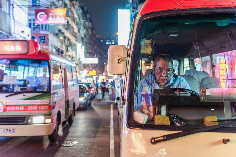 A bus driver waiting near the Temple Street night market