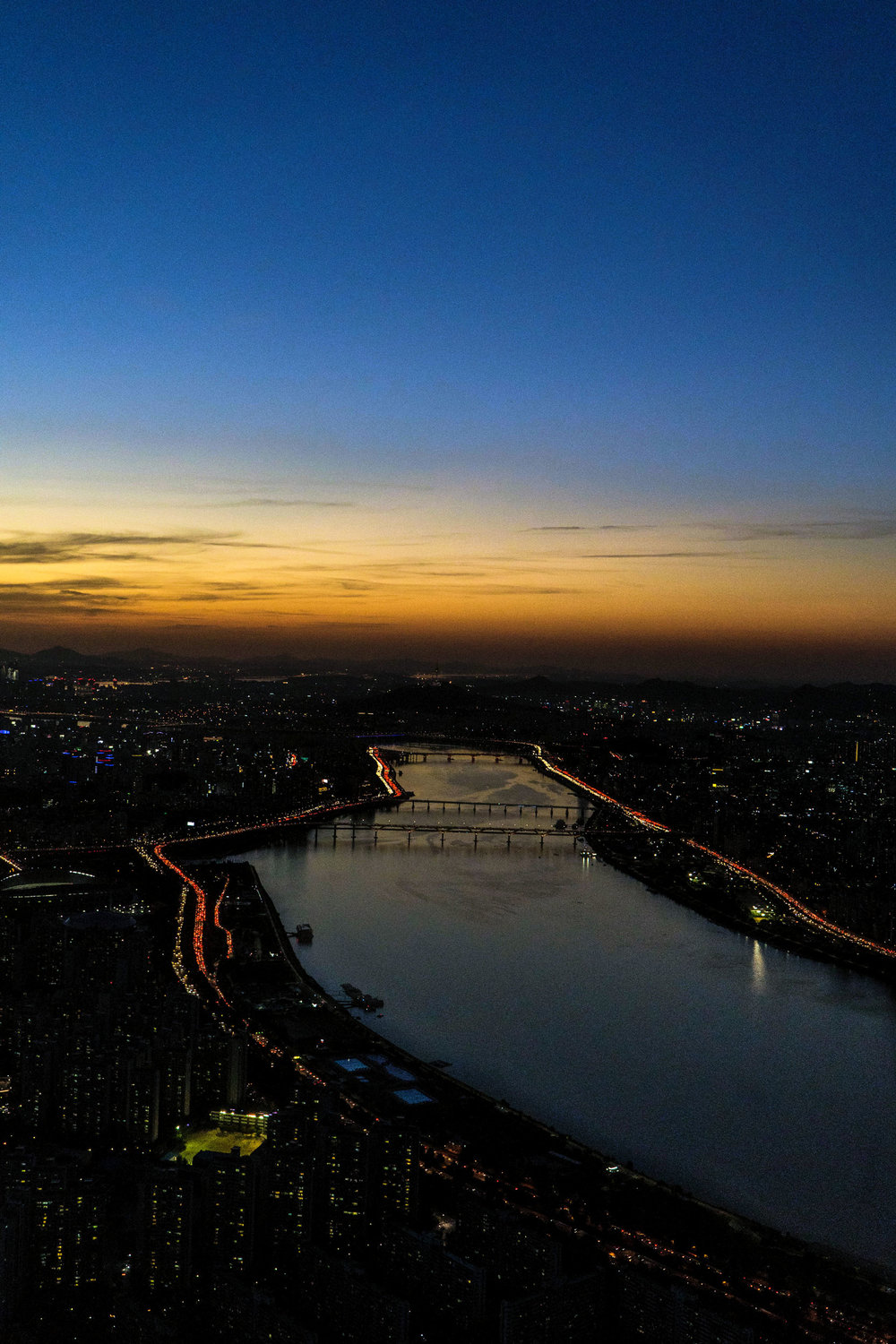 The view of Seoul at sundown from the Lotte World Tower