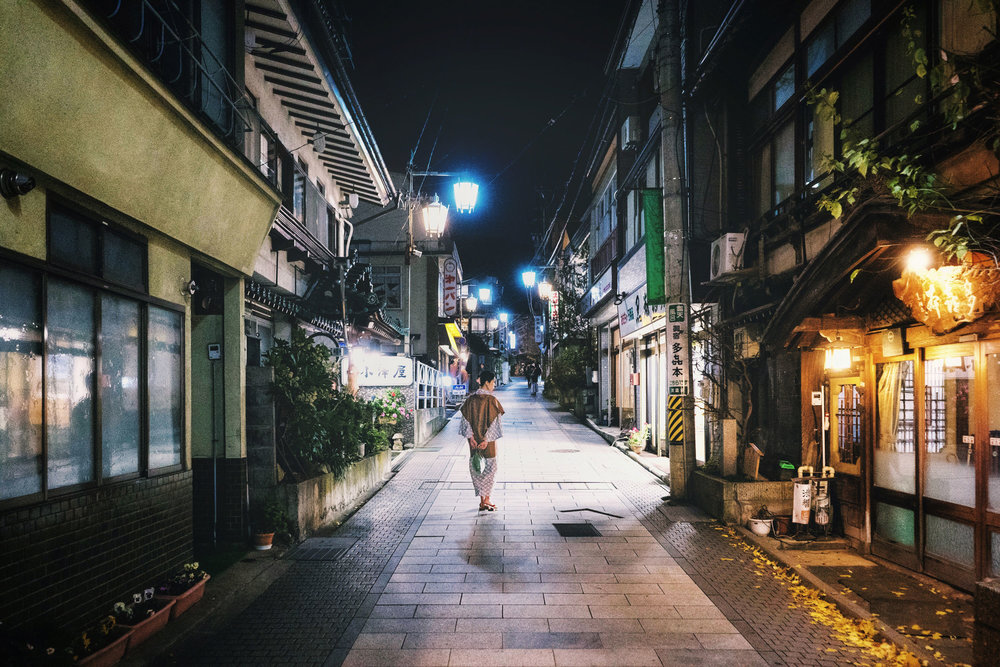 A woman walks through the streets of Shibu Onsen in Yamanouchi.