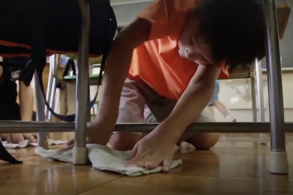Japanese students clean their schools