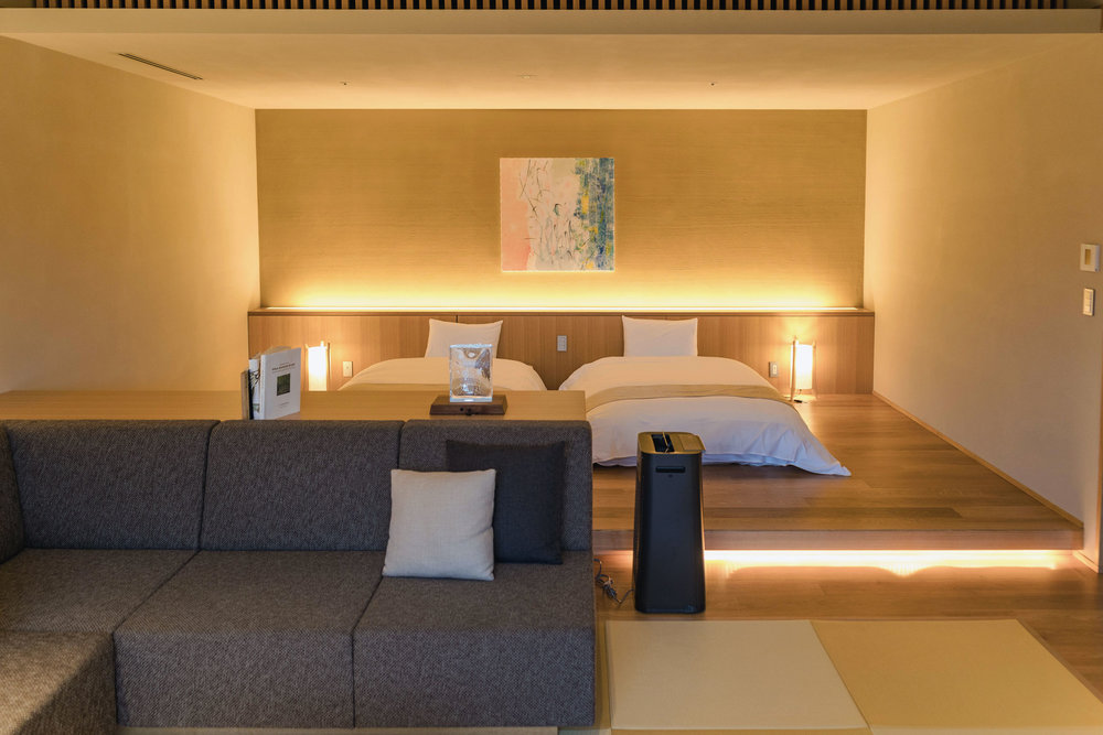 The bed area is attached to the living room and features gorgeous lighting accents