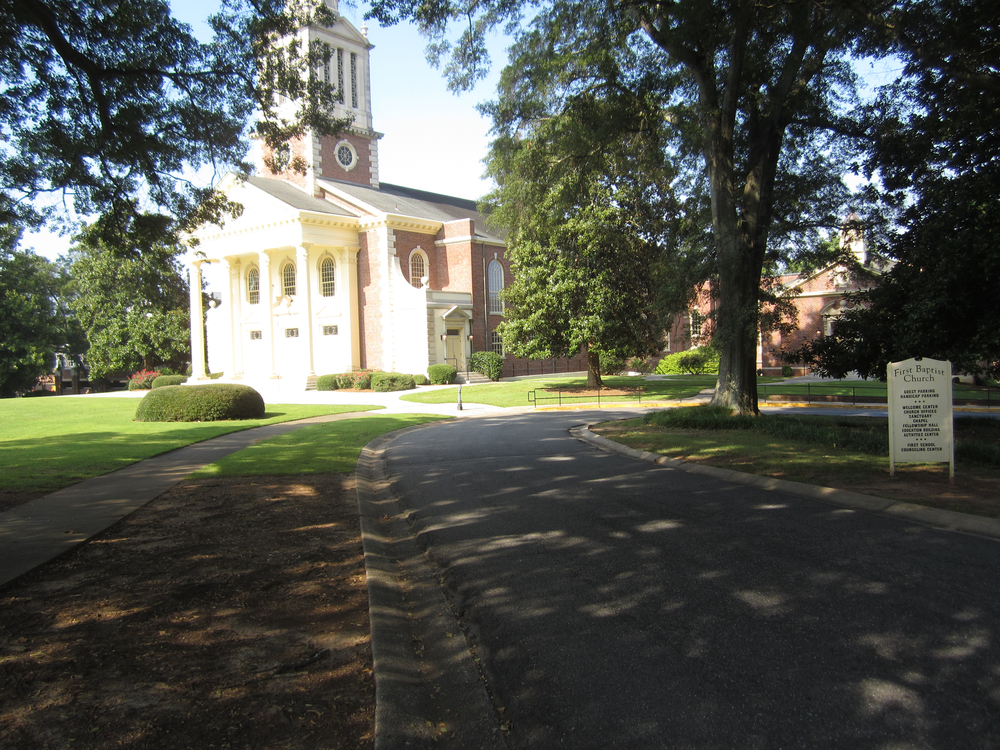 The driveway to the right of the Sanctuary curves by the Chapel and into the outside parking area.