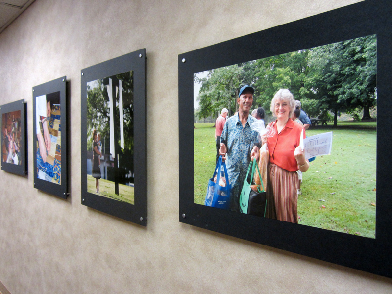 Pictures in the hall lead to the center hall to the right and your way to the children's check-in desk.