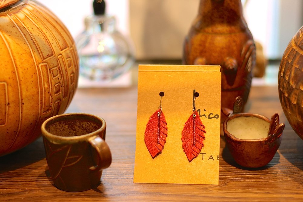Leather earrings and pottery.JPG