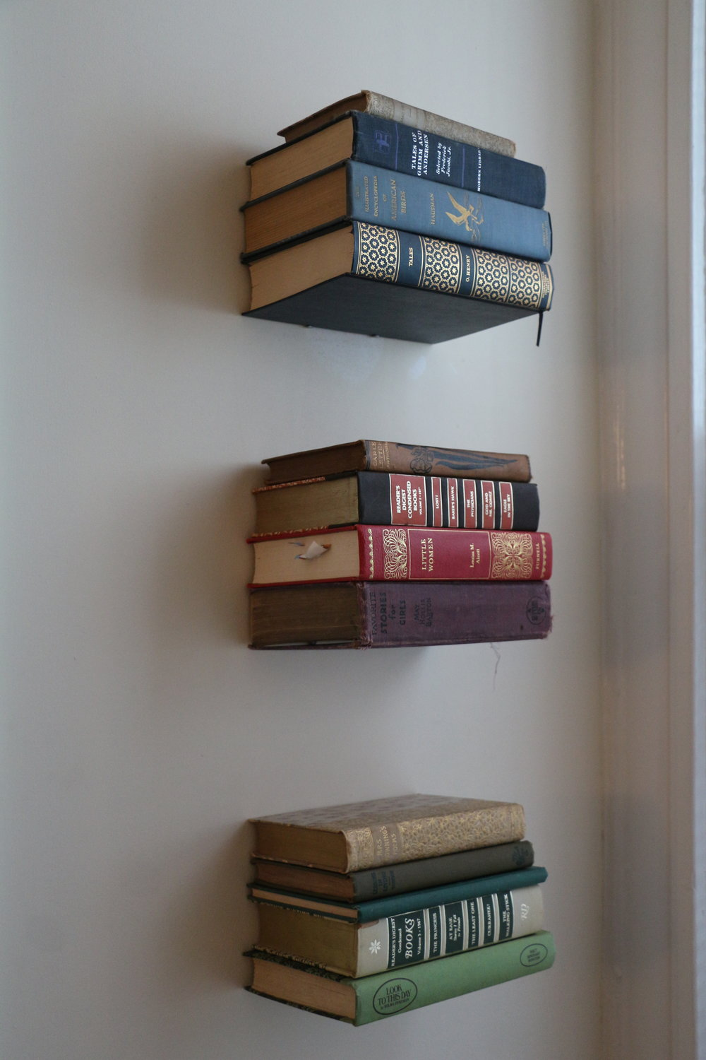 Invisible book shelves are my new favorite thing