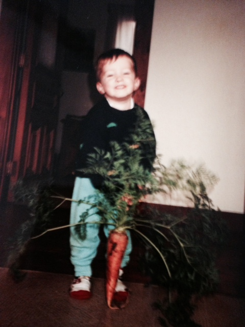 Jamie (age 2) with a carrot.