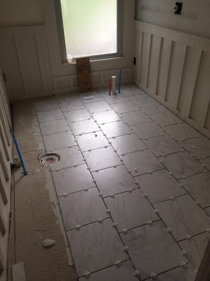 Marbled tile floor being installed