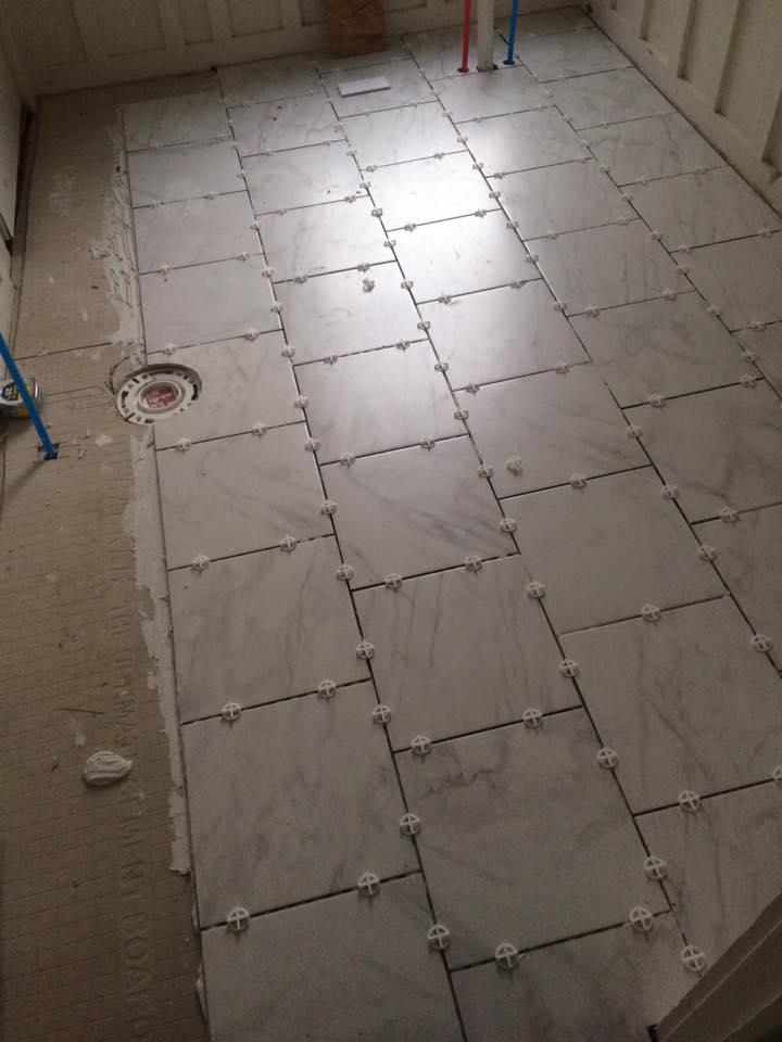 Marble tile floor being installed