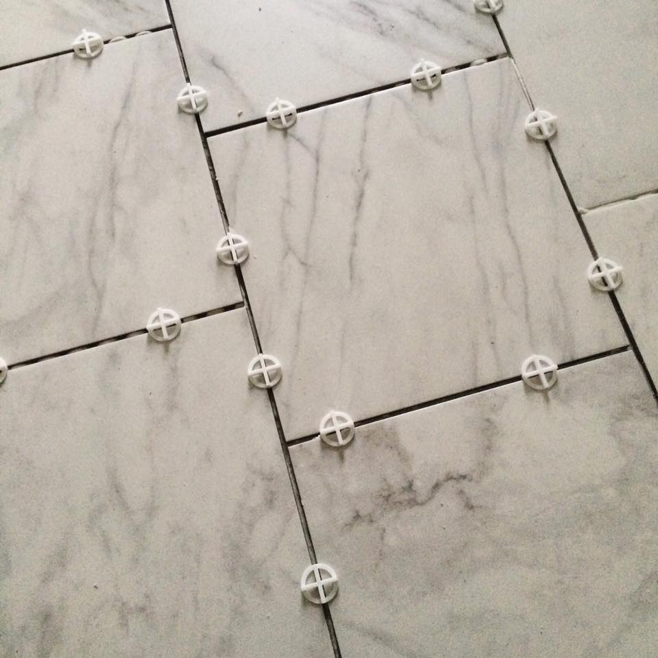 Close-up of tile floor in guest bath