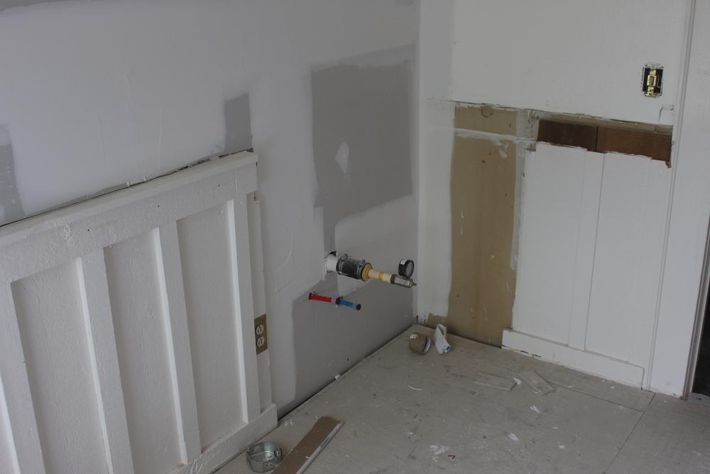 New plumbing/drywall where old sink vanity was