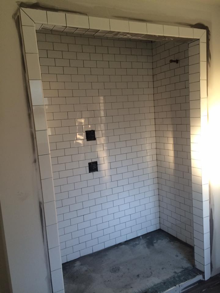 Walk-in shower with new subway tile