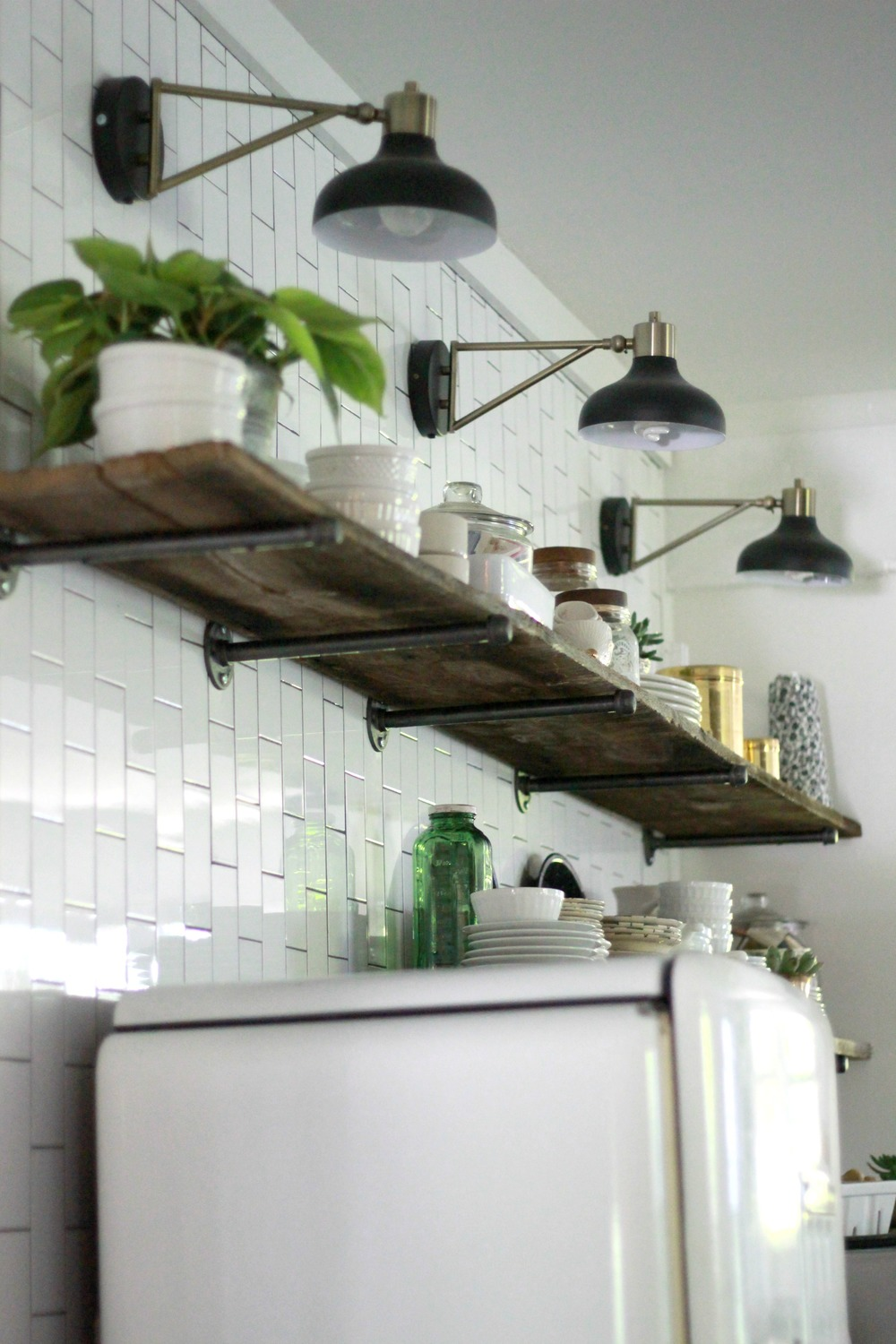 Fixer upper kitchen shelves - One Of My Favorite Focal Points Of The Room Is This Subway Tile Open Shelving Wall This Wall Holds My Beloved Vintage Refrigerator A 25 Garage Sale Find