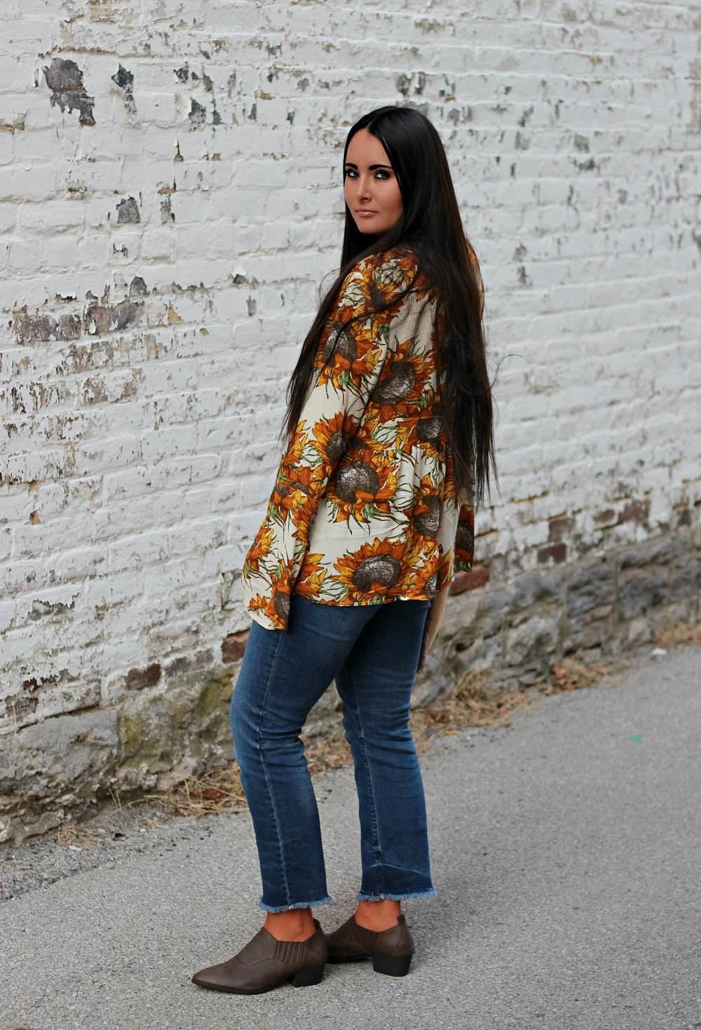20bab36a3d2 Sunflower lace-up peasant top: Umgee USA | Western booties: Target |  Cropped flare jeans: Old Navy (similar here) | Faux-fur tote: Anthropologie