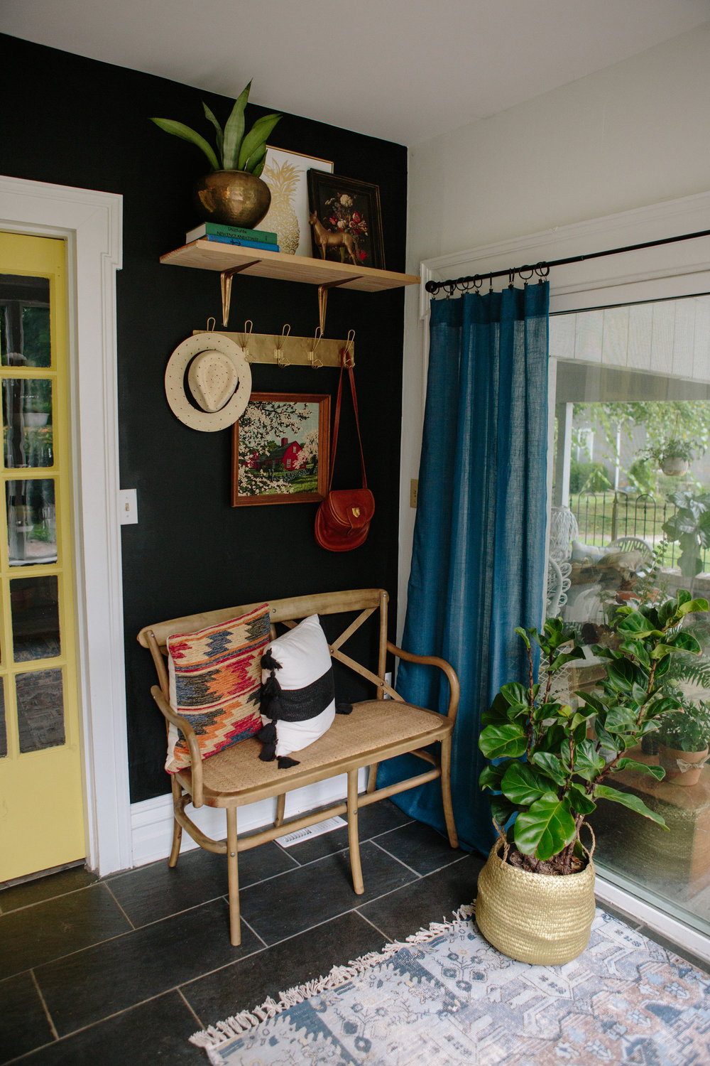 photo by  Sarah E Dunn Photo + Design    |   Rug: Homegoods (similar  here ,  here , +  here )   |     Bench    |    Gold metal coat rack: Homegoods (similar  here )   |   Kilim pillow: Homegoods (similar  here ,  here , +  here )   |   Gold pineapple print: Homegoods (similar  here  +  here )   |  Striped tassel pillow: Target-old (similar  here )   | Brass horse statue: Vintage (similar  here )   |  Brass planter (similar  here )   |    Gold basket for plant