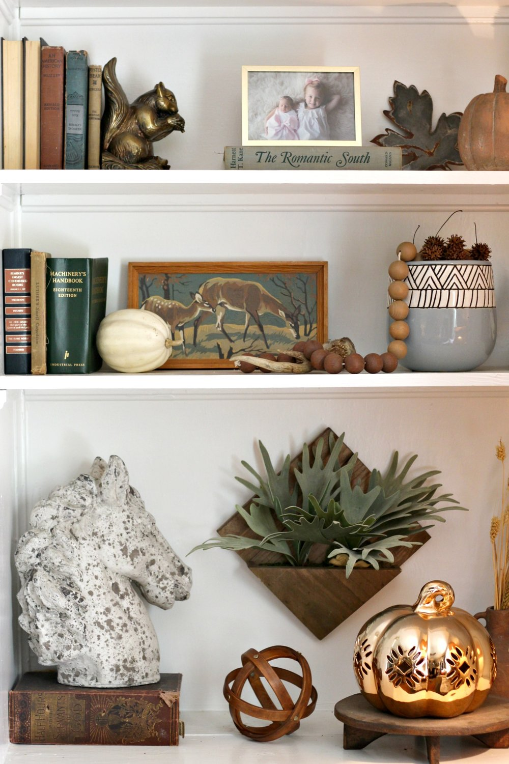 Wood sphere:  At Home    |    Copper pumpkin:  Homegoods    |   Horse statue:  Homegoods    |   Hanging faux plant:   Target (old)   |   Squirrel bookend: vintage |    Old books: vintage/thrifted |   Wood beads:  Target    |   Blue planter pot:  At Home    |    Deer paint-by-number: thrifted |  Metal leaf:  The Findery