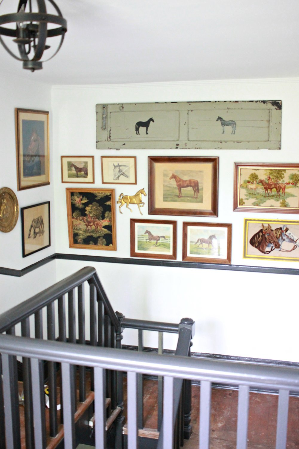 Vintage equestrian gallery wall in my home's entryway