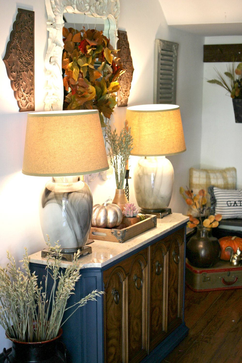 Fall leaf wreath: Trader Joe's   |    Wheat bundles: Gathered Living (linked above)   |    Lamps: thrifted   |    Tray:  Homegoods    |   Silver pumpkin:  Homegoods    |    Faux succulent: Target (linked above)