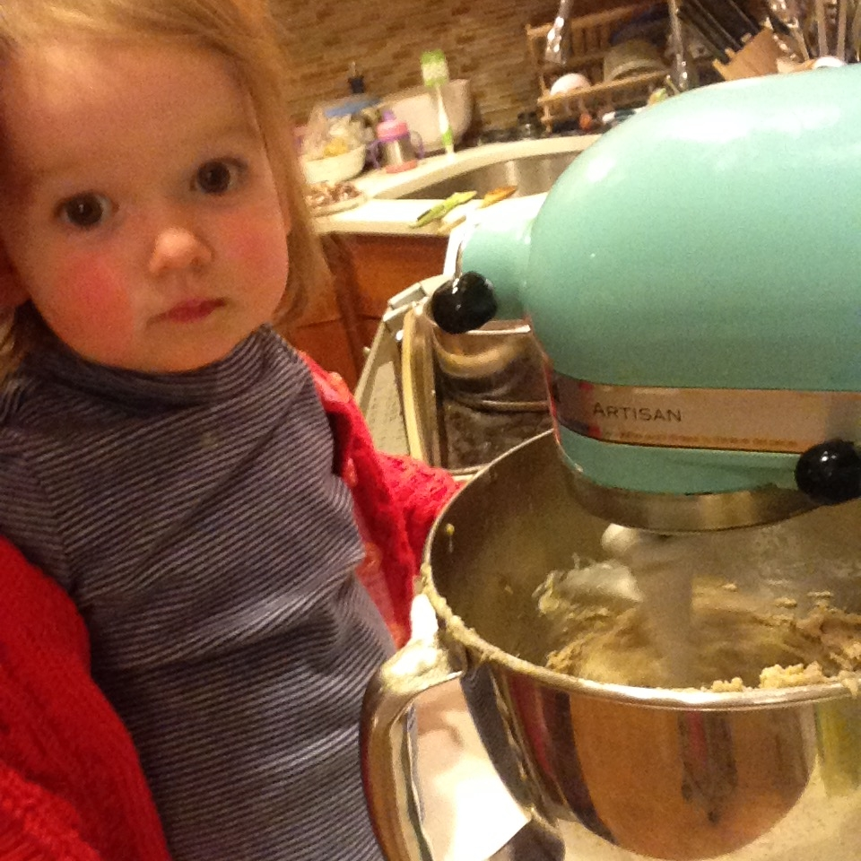 Harper helping me make a giant birthday cookie.