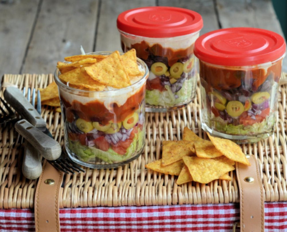 Layered salad in a jar from  Lavender and Lovage  -  starting from the bottom, lettuce, tomatoes, red onion, green olives, salsa and sour cream.  Don't add the chips on top until you are ready to eat. No one likes soggy chips.