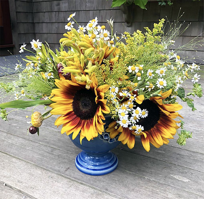 From the woman who did the flowers for my wedding,  Soiree Floral in Nantucket . Dawn is always posting the most beautiful, rustic looking arrangements. I see sunflowers, chamomile, what else….