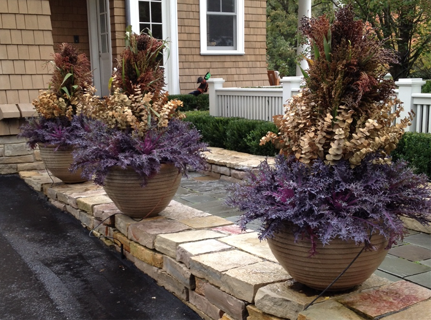 from the blog of  Deborah Silver, Dirt Simple  using broom corn in center of planter.