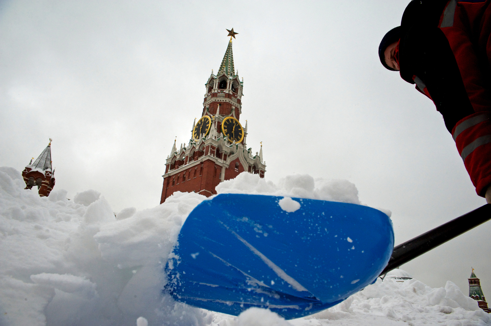 A worker cleans Red Square after  strong snowfall in Moscow.