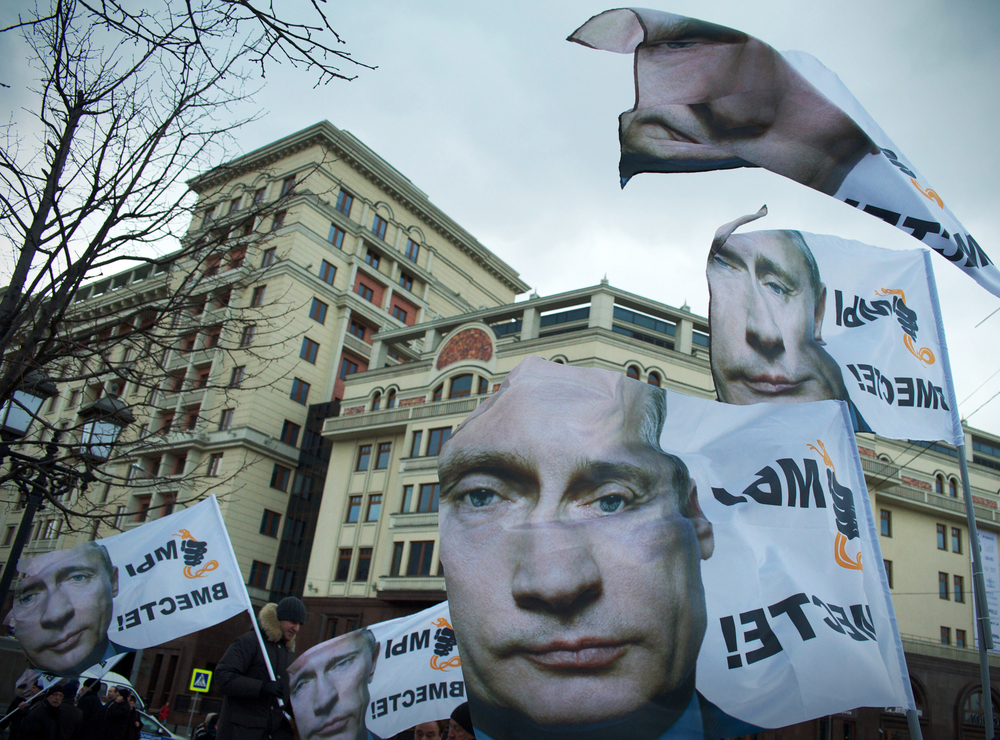 Flags with face of Vladimir Putin. Rally dedicated to accession Crimea to Russia, Moscow.