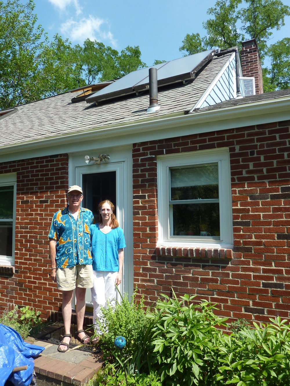 Bill and Patti say the solar hot water system in their Arlington home has cut their electric bills in half.