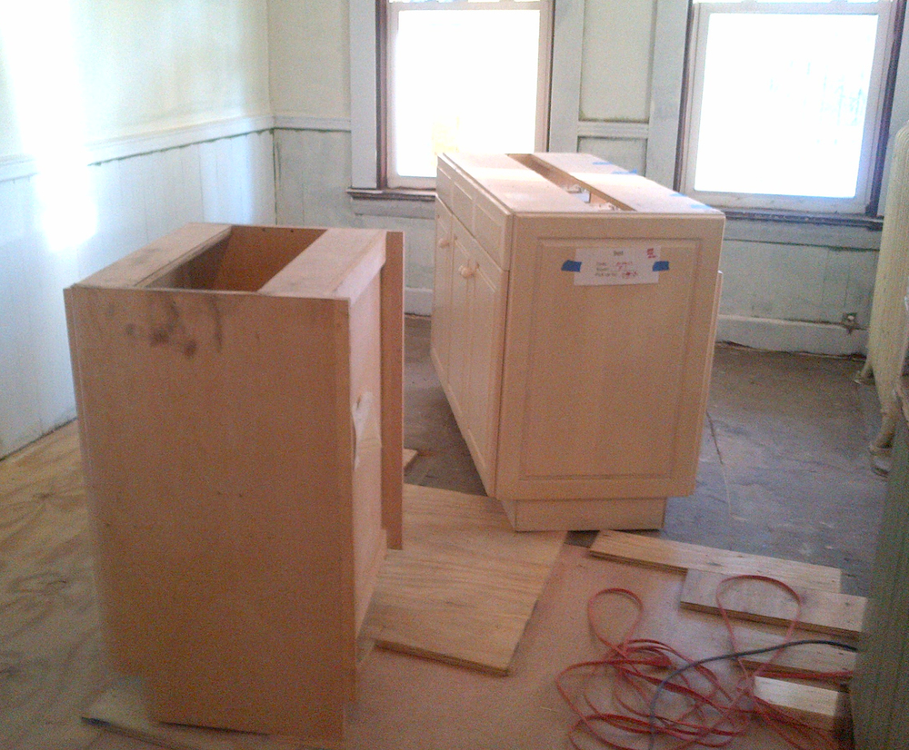 The large cabinet set she bought was enough for both kitchens.