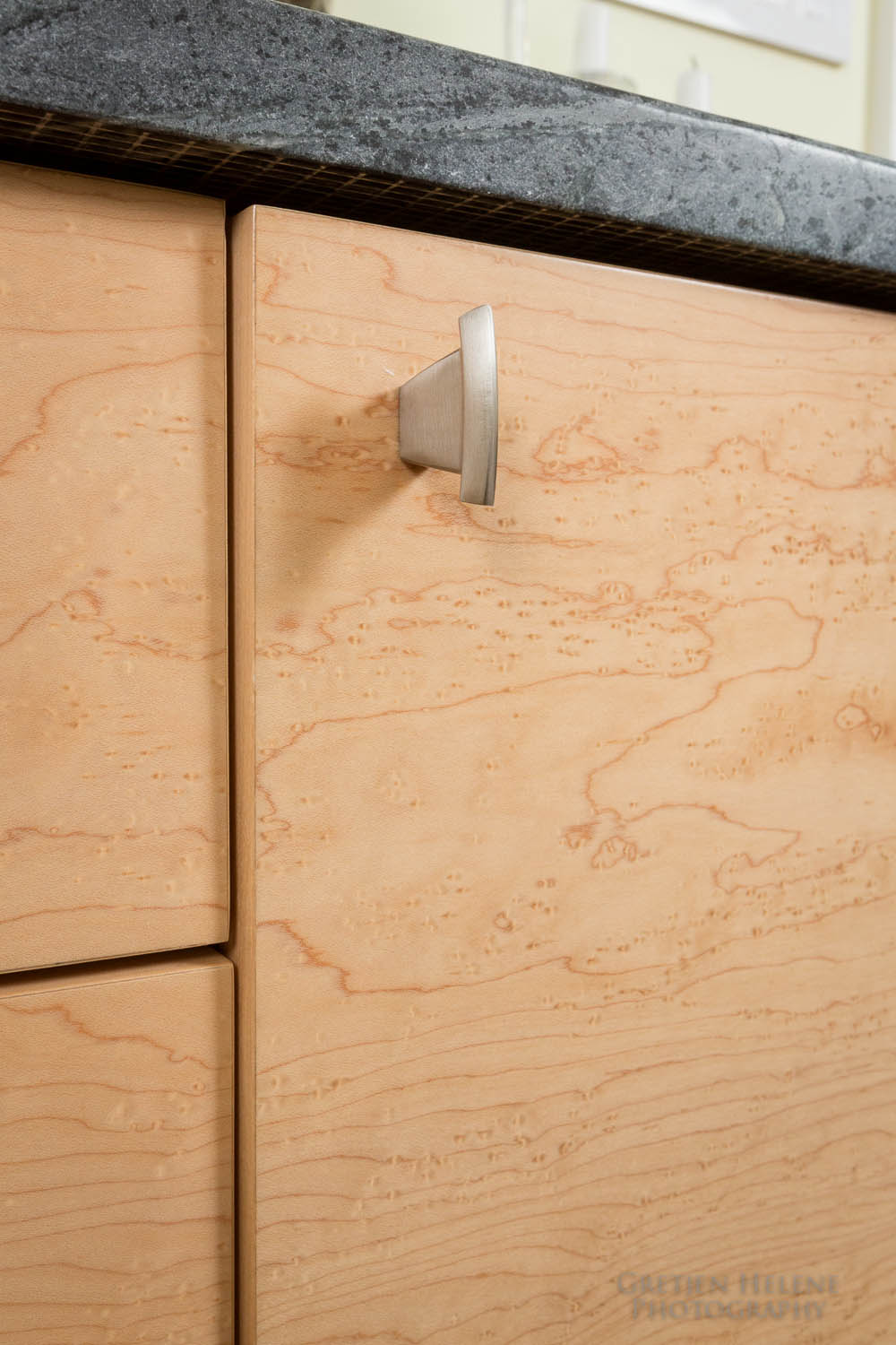 Buffet is crafted from bird's eye maple