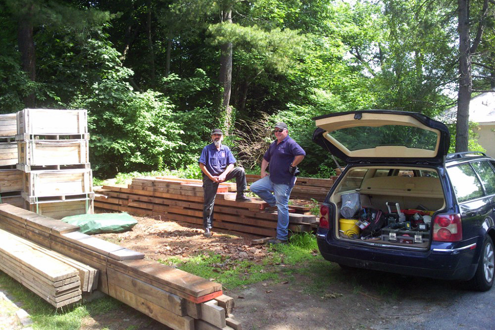 Paul and Greg prep lumber for transport