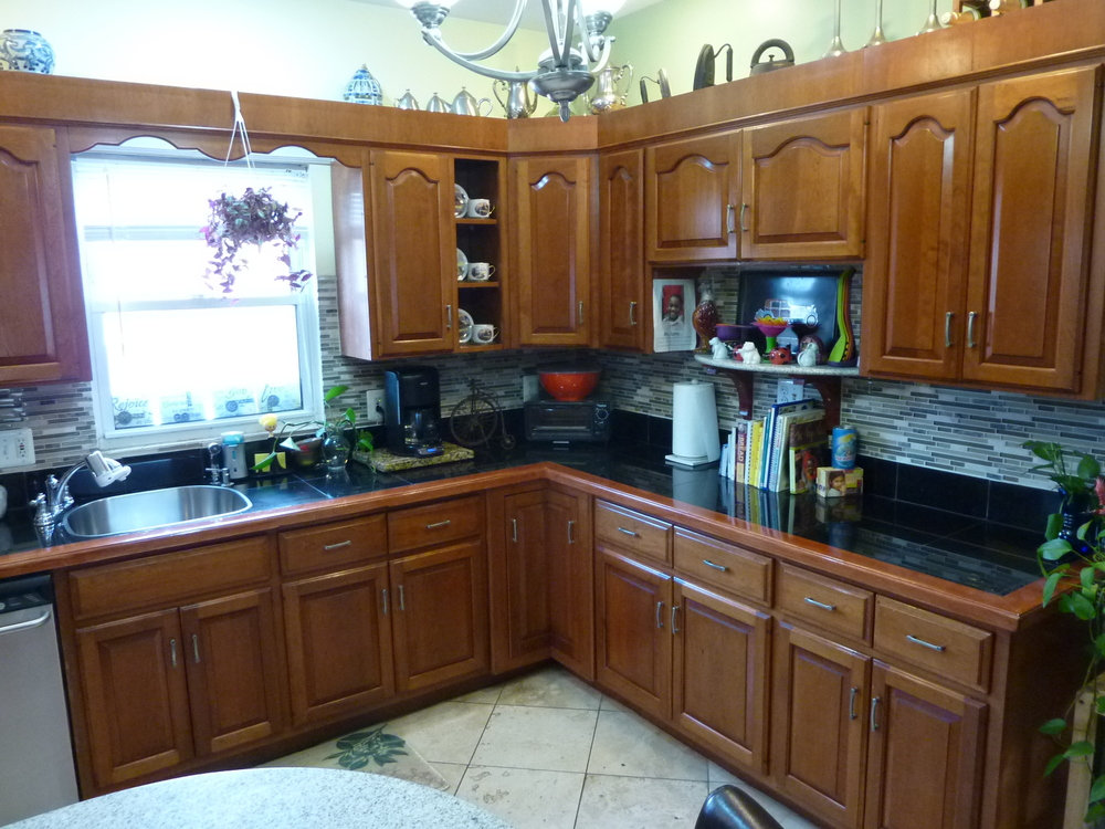 Counters are granite tile; floors are travertine.