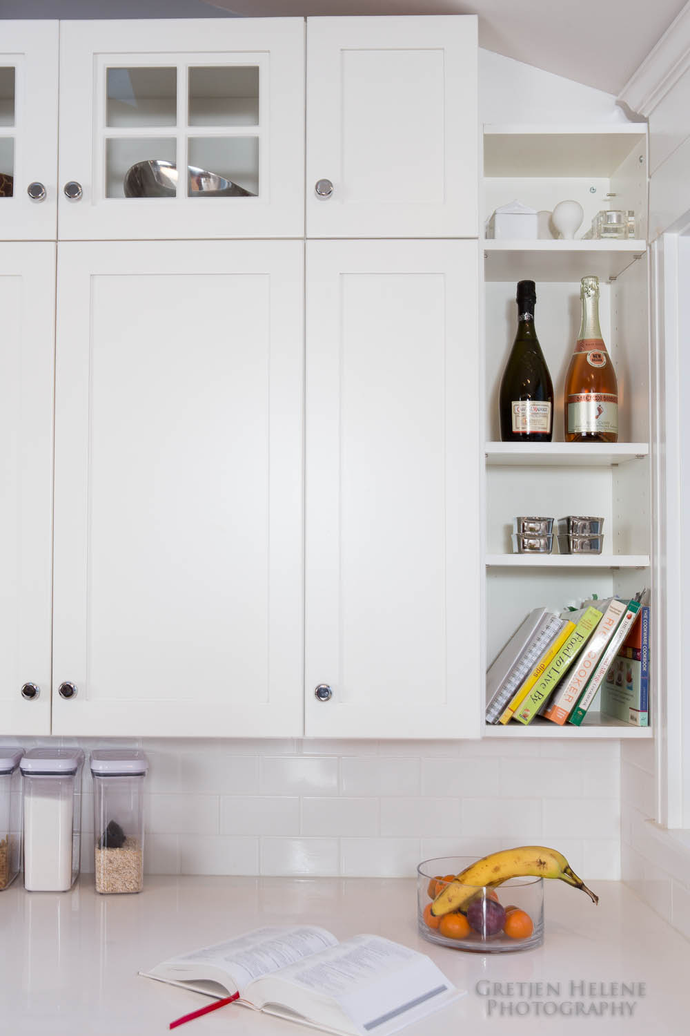 A few open shelves complement the cabinet doors.