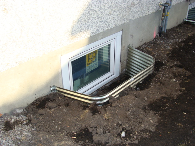 Window wells like this can be a point for water from melting snow to enter your basement. Image by  Legacy Windows  via  Flickr Creative Commons.