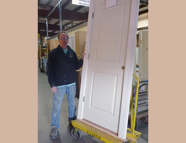 "John Hamilton picked up a two-panel pre-hung door. ""It would probably run $175 new."" John's cost: $50."