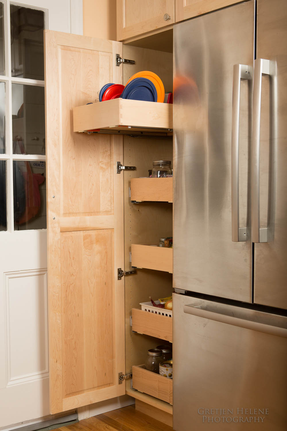 Pantry cabinet with pullouts adds storage