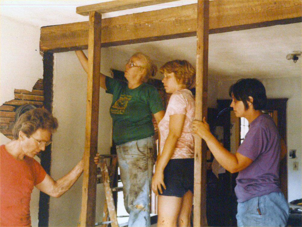 John, Lyn Garlord, Christine Rack, and Deborah Bernard work to remove a bearing wall.