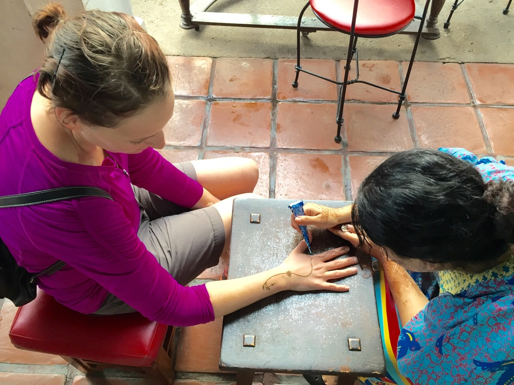 Marci getting the 'Health' henna tattoo.