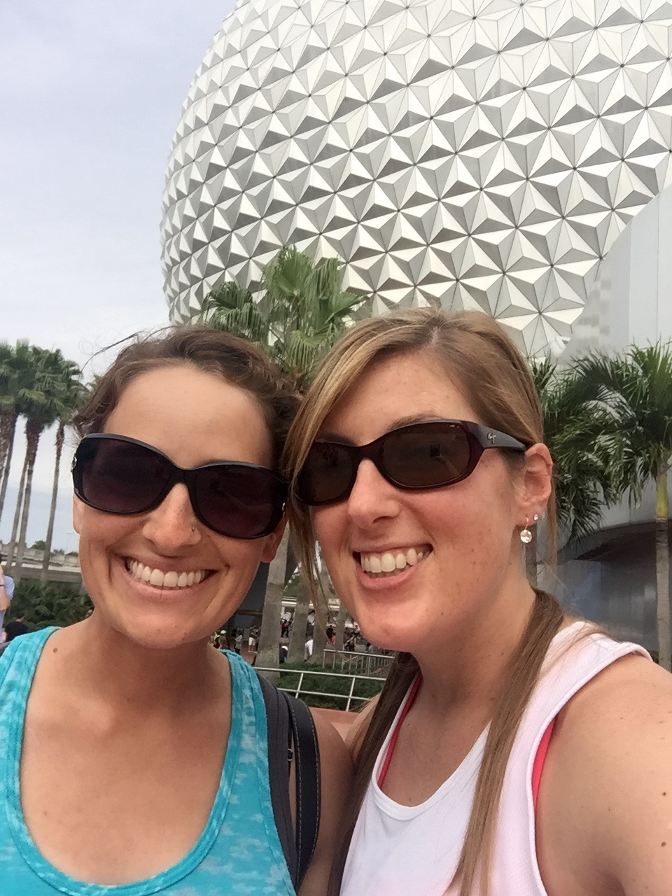 Having fun at Epcot waiting for our room to be ready.