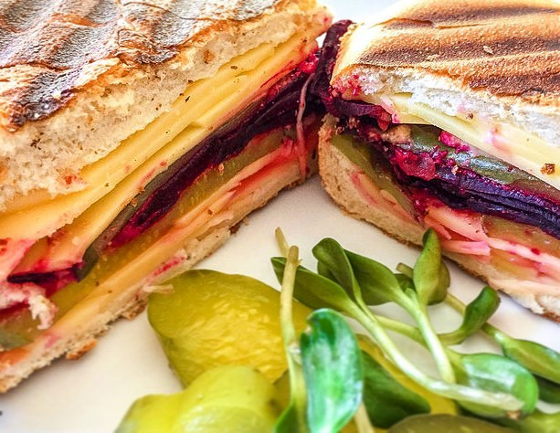 I used to love Cuban sandwiches. A grilled cheese with yumminess AND a pickle? Thankfully, because of the good people at Follow Your Heart I can make a similar plant based vegan friendly version with beets! Its insanely good and super easy to make!  Link in bio or get the recipe at www.thealohafiles.com #vegan #veganrecipes #meatlessmonday #plantpower #plantbased #plantstrong #delicious